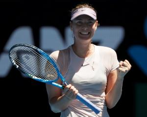 Maria Sharapova celebrates her win over Tatjana Maria. Photo: Reuters