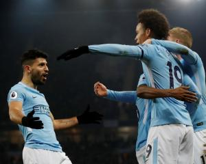 Sergio Aguero (L) celebrates his hat-trick against Newcastle United. Photo Reuters