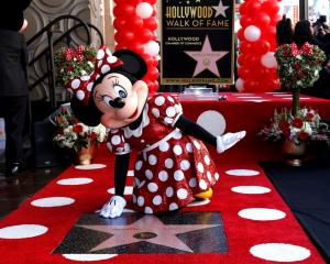 Minnie Mouse poses on her star after it was unveiled on the Hollywood Walk of Fame in Los Angeles...