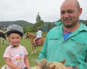 Lexie Nicholl and her dad Mike Nicholl, both of Waitahuna, relax with her Shetland pony, Jack,...