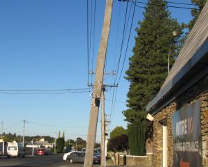 A power pole  at the corner of Centennial Ave and Shannon St in Alexandra stands on an angle....