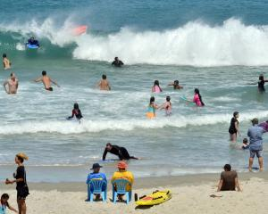 Crowds pack into the surf at St Kilda Beach during a very warm summer day yesterday.