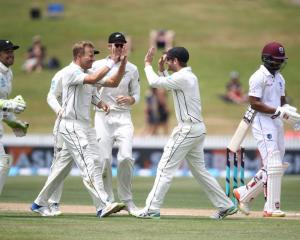 Neil Wagner celebrates taking a wicket with his Black Caps team mates against the West Indies in...