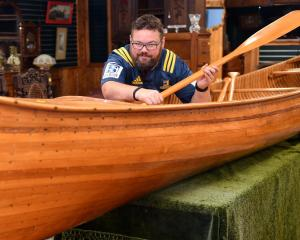 Dunedin auction house manager Ronnie Proctor with a Peterborough Canadian canoe. Photo: Stephen...