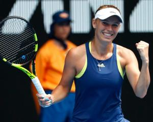 Caroline Wozniacki celebrates her quarterfinal win last night at the Australian Open. Photo:...