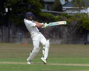 Albion batsman Josh Tasman-Jones pulls the ball through the onside on his way to scoring a match...