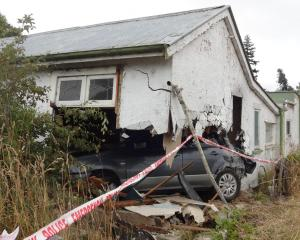 A car smashed into the side of a house after plunging down a bank in Palmerston early yesterday...