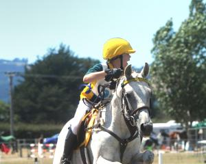 Kyla Garmonsway (13) looks for the next jump to take on her horse, Southwind Summer Rose. They...