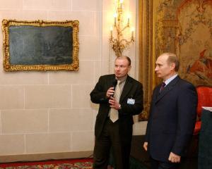 President of Russia, Vladimir Putin (right) and Vladimir Potanin (left). Photo: Getty Images