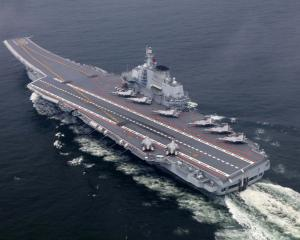 The Chinese Aircraft Carrier Liaoning is seen during a training mission in July last year. Photo...