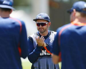 Black Caps coach Mike Hesson holds a team talk during game one of the Twenty20 series between New...