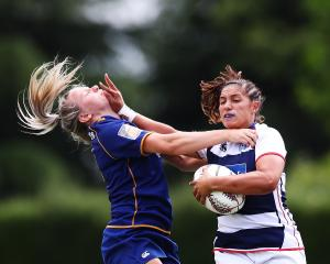 Auckland player Lara Diamond-Brahne fends off Otago's Zoey Flockton during the quarterfinals of...