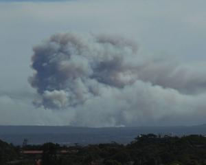 The bushfire, seen from Royal Randwick Racecourse, burns south of Sydney. Photo Getty