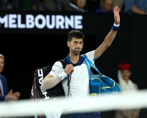 Novak Djokovic farewells the crowd after losing his match against Hyeon Chung. Photo: Getty Images
