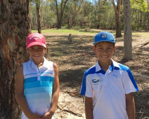Golfing prodigies Anahera (8) and Kairangi (9) pause for a photograph with a kangaroo while at...