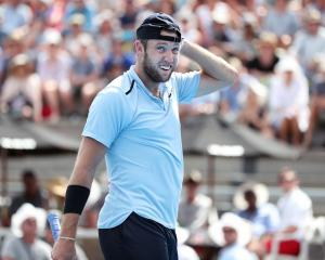 Jack Sock of USA reacts to a call in his second round match against Peter Gojowczyk of Germany...