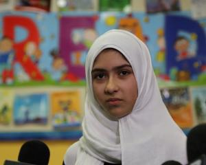 Khawlah Noman speaks to reporters at Pauline Johnson Junior Public School in Toronto. Photo: Reuters