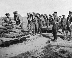 The battle of Broodseynde: Loading shells on a truck for a move forward. — Otago Witness, 16.1.1918.