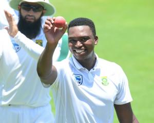 Lungi Ngidi celebrates taking 6 for 39 on debut in South Africa's win over India. Photo: Getty...