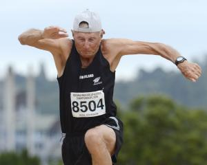 Ron Johnson during his record-breaking triple jump performance at the Oceania Masters Athletics...