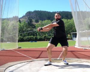 Mike Scholten  trains for the hammer throw at the Caledonian Ground ahead of the Oceania Masters...