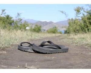 Still life . . . A pair of Jandals sits on the shore of Lake Benmore. Photo: Kourtney Rogers (15)