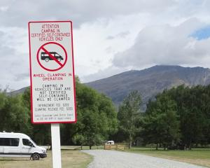 The Queenstown Lakes District Council posts stern warnings at popular camping areas, including...