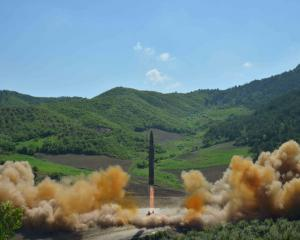 The intercontinental ballistic missile Hwasong-14 is seen during its test launch. Photo: Reuters