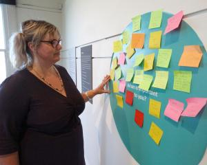 Forrester Gallery education curator Liz King reads some of the messages left by people about what...