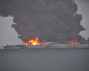 Smoke and fire is seen from Panama-registered tanker Sanchi carrying Iranian oil after it...