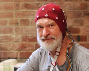 ADInstruments software engineer Peter Jaquiery models an electroencephalography cap plugged into...