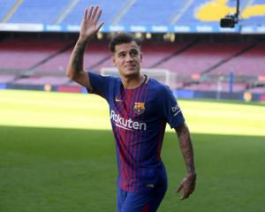 Phillipe Coutinho waves at Camp Nou after being introduced at Barcelona. Photo: Getty Images