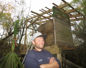 Glenn Raymond, pictured last April with the island tree hut he has since been ordered to...
