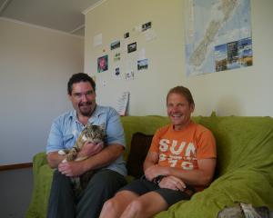 Couch surfer Stefan Weber (right) is one of more than 200 people Gary Green and his cat Monster...