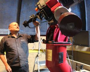 Dunedin Astronomical Society volunteer Stu Todd checks the camera on the main telescope at...