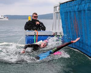 Stefannie Gillespie reaches for the finishing line to beat Australian Kate Dryden and win the...