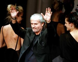 Italian designer Gianni Versace at one of his fashion shows in 1997. Photo: Reuters