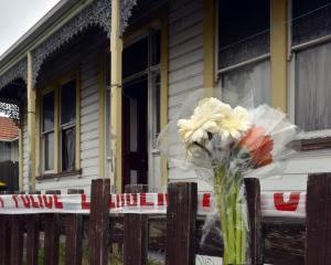 A bouquet of flowers is placed outside a Wesley St property after a fatal fire in Dunedin...