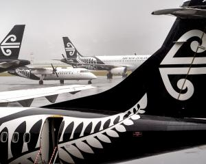 Air New Zealand planes stack up at Wellington Airport as flights are cancelled yesterday. Photo:...