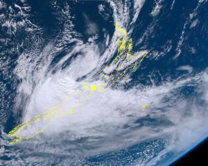 Ex Tropical Cyclone Gita lies over the Cook Strait and the top of the South Island 20 February...