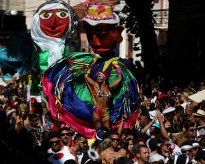"Revellers take part in the annual block party known as ""Carmelitas"", during carnival festivities..."