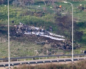 The remains of an F-16 Israeli war plane can be seen near the Israeli village of Harduf. Photo:...