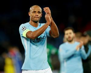 Manchester City's Vincent Kompany applauds fans after their match against FC Basel. Photo: Reuters