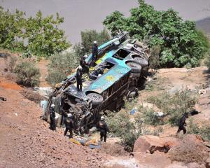 Rescue workers at the scene after the crash. Photo Reuters