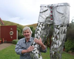 Alexandra artist Olaf Mengeringhausen with his sculpture Re-Lax, which is on display at the...