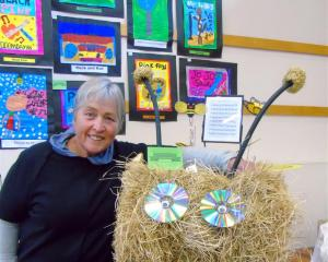 "Lynley McDonald, of Kyeburn, stands by her entry titled ""Flight of the bumblebee'' in the feature..."