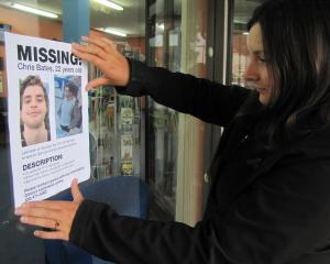 Bates family spokeswoman Sidonee Gibson puts up a flier about the search for Christopher Bates....