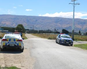 Armed police at the intersection of Corrigall and White Rds near Omakau yesterday afternoon,...