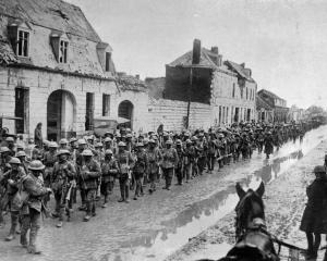 On the Western Front: British troops returning to a rest camp after several days fighting in the...