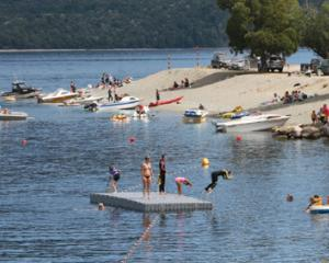 Blue Gum Point, Te Anau Boat harbour, a hub for recreational boaties and swimmers using the...